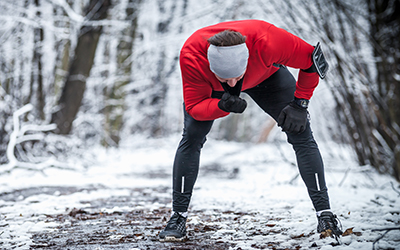 Man takes a break during outdoor training in winter.