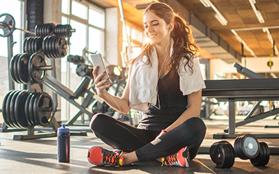 woman rests on gym floor after completing her exercise