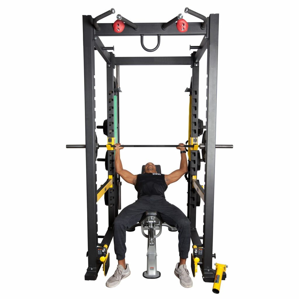 Fitness First power rack with athlete using the power rack for bench press.